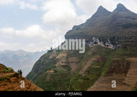 Ha Giang, Vietnam - March 18, 2018: Scenic mountain landscape with rice terraces at Ma Pi Leng pass in northern Vietnam - Stock Photo