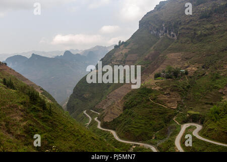 Ha Giang, Vietnam - March 18, 2018: Stunning view of terraced land and high mountains at Ma Pi Leng pass, one of the most dangerous roads of Vietnam - Stock Photo