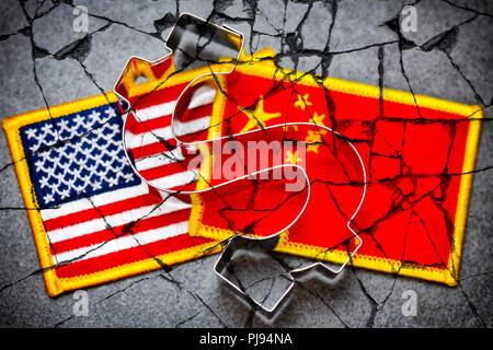 Dollar signs on the flags of the USA and China, commercial war, Dollarzeichen auf den Fahnen von USA und China, Handelskrieg - Stock Photo