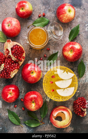 The Jewish New Year. Red apples, pomegranate and honey. Rosh Hashana. Top view, overhead, flat lay - Stock Photo