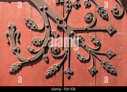 Ornate metal fittings on wooden door, Strasbourg, France - Stock Photo