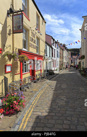 Staithes cobbled High Street, North Yorkshire, North York Moors National Park, England, UK. - Stock Photo