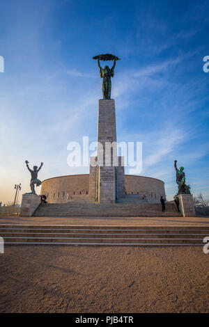 BUDAPEST / HUNGARY - FEBRUARY 02, 2012: View of historical landmark Liberty Statue located in the capitol of the country, shot taken during winter sun - Stock Photo
