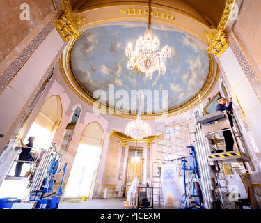 The Royal Pavilion in Brighton, East Sussex opens the newly restored Saloon to visitors this weekend Saturday 8th September 2018. Picture shows the platinum leaf wallpaper being restored in 2016 and 2017 part way through the restoration. - Stock Photo