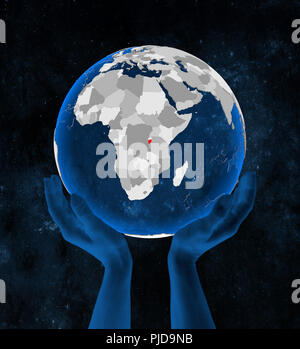 Burundi on translucent blue globe held in hands in space. 3D illustration. - Stock Photo