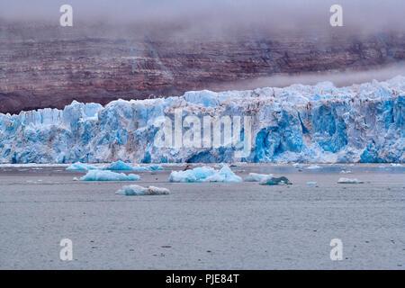 blue ice of Kronebreen or Crown glacier, Kongsfjord, Ny-Ålesund, Svalbard or Spitsbergen, Europe - Stock Photo