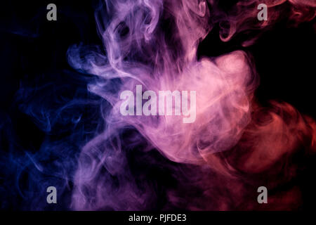 Dense multicolored smoke of  pink,  blue and purple colors on a black isolated background. Background of smoke vape - Stock Photo