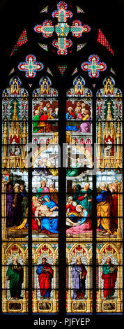 Cologne Cathedral, stained glass Window of Lamentation, 1847, corpse of Christ on His Mother's knees; Last Supper above. - Stock Photo