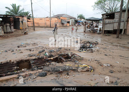 Flow in a street in a poor neighborhood. Lome. Togo. - Stock Photo