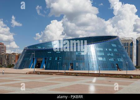 Astana, Kazakhstan, August 3 2018: The Shabyt Palace of Creativity building, nicknamed the Dog Bowl, in Astana, the capital of Kazakhstan - Stock Photo