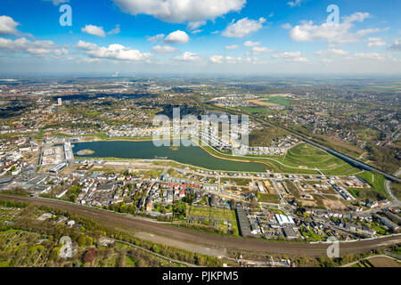 Phoenix Lake is an artificial lake on the former steelworks Phoenix East in Dortmund district Hörde, recreational area, residential area, rainwater retention basin, Dortmund, Ruhr, North Rhine-Westphalia, Germany - Stock Photo