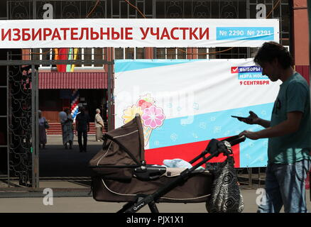Moscow, Russia. 09th Sep, 2018. MOSCOW, RUSSIA - SEPTEMBER 9, 2018: A woman with a baby stroller at a polling station on Single Voting Day. Russia elects the heads of 26 regions, members of the legislative assemblies of 17 regions and 7 State Duma members. Mikhail Tereshchenko/TASS Credit: ITAR-TASS News Agency/Alamy Live News - Stock Photo