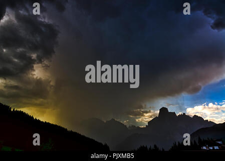 Storm clouds and downpour on the mountains of Alta Badia in summer sunset, Corvara in Badia - Trentino-Alto Adige, Italy - Stock Photo