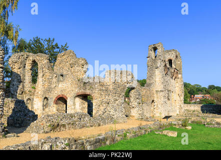 Ruins of ancient medieval Wolvesey Castle (Old Bishop's Palace) in Winchester, Hampshire, southern England, UK on a bright sunny day with blue sky - Stock Photo