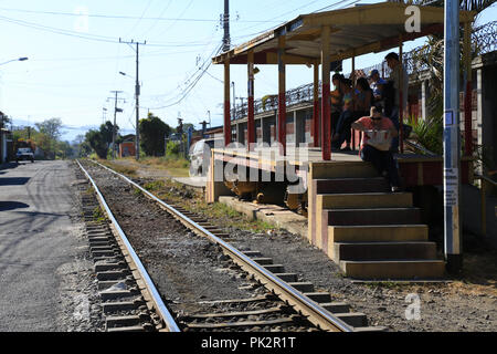 People waiting the train in the country side station, San Jose, Costa Rica - Stock Photo
