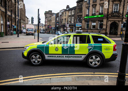 First responders Paramedic in an Ambulance Responder car in Huddersfield, West Yorkshire, England - Stock Photo