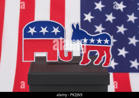 2020 US Presidential Election / Midterm election America 2018. GOP / Republican elephant & Democratic Donkey logos (patche) & ballot box, election USA - Stock Photo