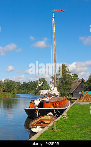 A view of the Norfolk Pleasure Wherry Hathor moored on the River Ant by How Hill, Ludham, Norfolk, England, United Kingdom, Europe. - Stock Photo