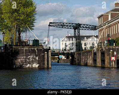 Lifting bridge of the drawbridge type on an Amsterdam canal. - Stock Photo