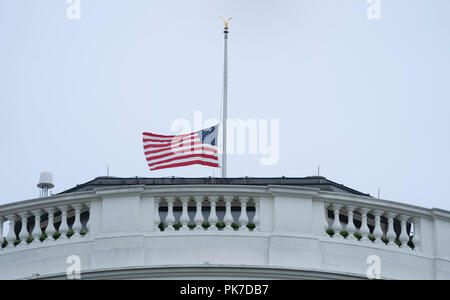 Washington, United States Of America. 11th Sep, 2018. The flag over The White House in Washington, DC flies at half staff on the 17th anniversary of the September 11, 2001 attacks, September 11, 2018. Credit: Chris Kleponis/CNP | usage worldwide Credit: dpa/Alamy Live News - Stock Photo