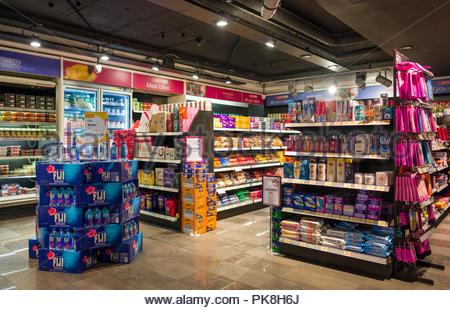Shelfs with sundry food and other items on sale in Spar convenience retail shop, Merrion Row, Dublin, Leinster, Ireland - Stock Photo