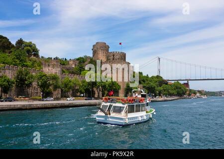 Rumeli Castle and bridge across Bosphorus, Golden Horn, Istanbul, Turkey - Stock Photo