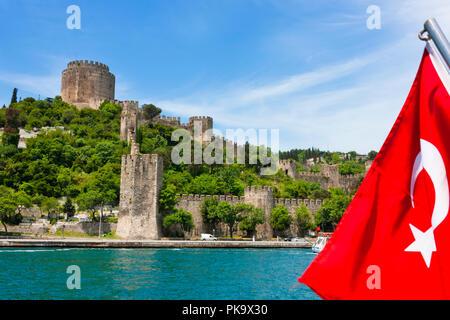 Rumeli Castle and national flag, Istanbul, Turkey - Stock Photo