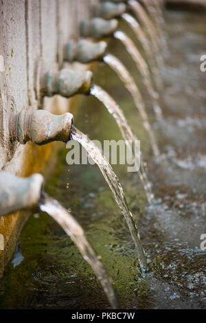 loss of water - the fall of water from water taps - Stock Photo