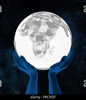 Burundi In red on white globe held in hands in space. 3D illustration. - Stock Photo