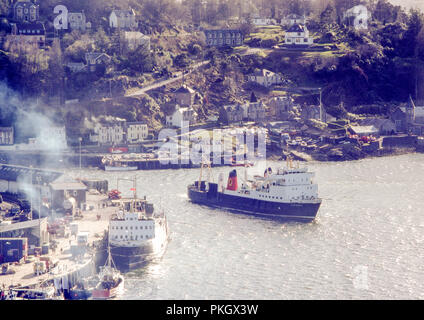 Caledonian MacBrayne (CalMac) Ferry named Claymore sailing out of Oban Harbour in May 1980. Original archival image. - Stock Photo