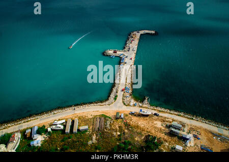 Fishing pier shot from the top of a hill - Stock Photo