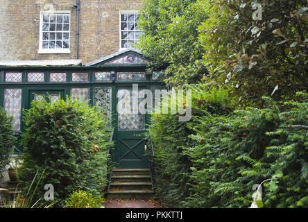 The front of an unusual house in Keat's Grove, with a conservatory, Hampstead, London NW3, England, UK - Stock Photo
