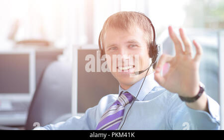 Happy young business man in headset working on computer. - Stock Photo