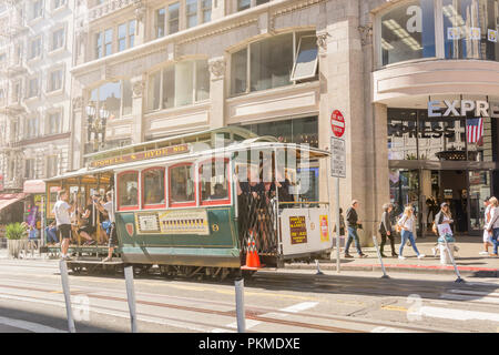San Francisco, CA, USA, October 21st 2016: Tourists enjoying Powell Hyde cable car system transportation in a sunny day in San Francisco - Stock Photo