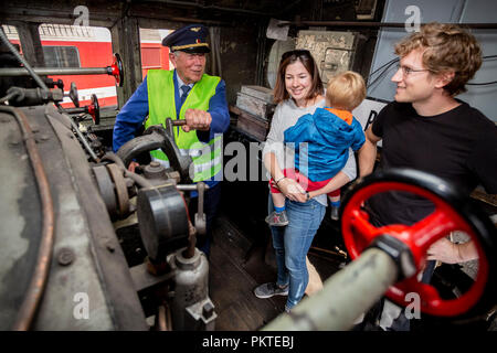 15 September 2018, Berlin: Claus Winter stands in the driver's cab of a steam locomotive at the 15th Berlin Railway Festival in the Schöneweide depot, where he welcomes visitors. Steam trains are the focus of the two-day event. The association Dampflokfreunde Berlin presents more than 20 locomotives and wagons. Photo: Christoph Soeder/dpa - Stock Photo