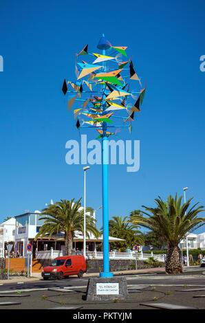El Robalo, colorful wind chime designed by Cesar Manrique on the promenade at Playa Matagorda, Puerto del Carmen, Lanzarote - Stock Photo