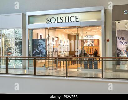 AVENTURA, USA - AUGUST 23, 2018: Solstice sunglasses famous boutique in Aventura Mall. - Stock Photo