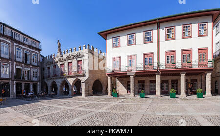 Guimaraes, Portugal - October 13, 2017: Old Town-Hall (Antigos Pacos do Concelho) in Oliveira Square in the Historical Center. Unesco World Heritage S - Stock Photo