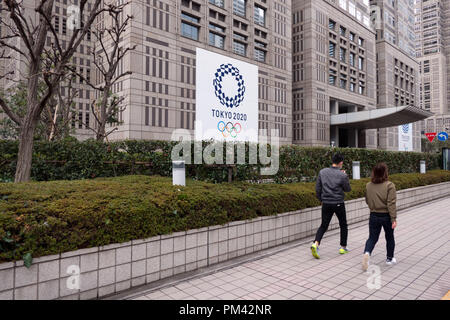 Sign for the Tokyo 2020 Summer Olympics, the Games of the XXXII Olympiad, on a building in Tokyo, Japan, Asia - Stock Photo