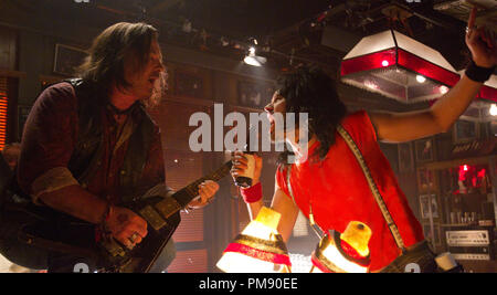 (L-r) ALEC BALDWIN as Dennis Dupree and RUSSELL BRAND as Lonny in New Line Cinema's rock musical 'ROCK OF AGES,' a Warner Bros. Pictures release. - Stock Photo
