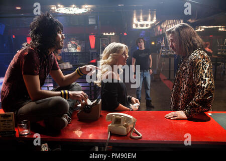 (L-r) RUSSELL BRAND as Lonny, JULIANNE HOUGH as Sherrie Christian, DIEGO BONETA as Drew Boley, and ALEC BALDWIN as Dennis Dupree in New Line Cinema's rock musical 'ROCK OF AGES,' a Warner Bros. Pictures release. - Stock Photo
