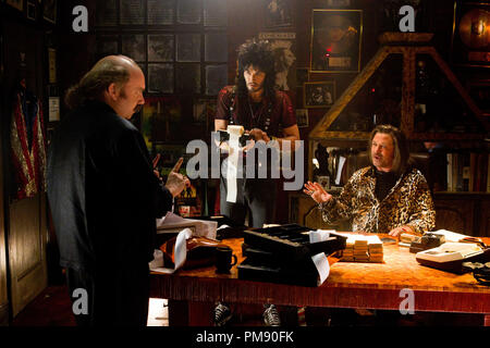 (L-r) PAUL GIAMATTI as Paul Gill, RUSSELL BRAND as Lonny, and ALEC BALDWIN as Dennis Dupree in New Line Cinema's rock musical 'ROCK OF AGES,' a Warner Bros. Pictures release. - Stock Photo