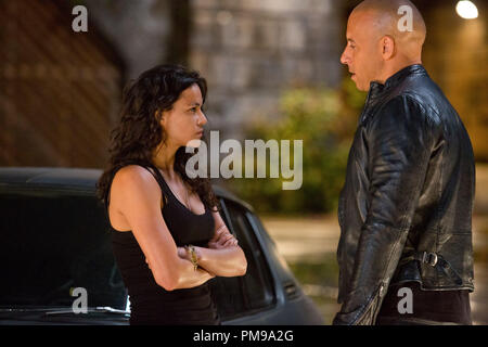 Letty (MICHELLE RODRIGUEZ) cautiously greets Dom (VIN DIESEL) in 'Fast & Furious 6', the next installment of the global blockbuster franchise built on speed. - Stock Photo