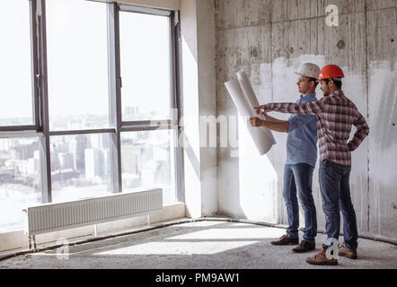 attractive architector and engineer are planning their work. architectural work - Stock Photo