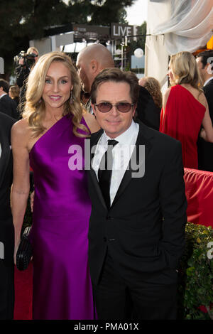 Actress Tracy Pollan and actor Michael J. Fox attend the 70th Annual Golden Globe Awards at the Beverly Hilton in Beverly Hills, CA on Sunday, January 13, 2013. - Stock Photo