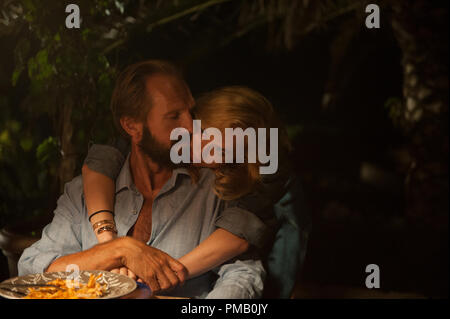 "Ralph Fiennes as ""Harry Hawkes"" and Dakota Johnson as ""Penelope Lanier"" in A BIGGER SPLASH. © 2015 Twentieth Century Fox Film Corporation All Rights Reserved - Stock Photo"