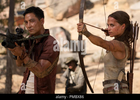 (L-R) DANIEL WU as Lu Ren and ALICIA VIKANDER as Lara Croft in Warner Bros. Pictures' and Metro-Goldwyn-Mayer Pictures' action adventure 'TOMB RAIDER,' a Warner Bros. Pictures release. - Stock Photo