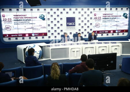 Moscow, Russia. 19th Sep, 2018. MOSCOW, RUSSIA - SEPTEMBER 19, 2018: Vsevolod Vukolov, head of the Russian Federal Service for Labour and Employment, and Robert Urazov (L-R background), Director General of the Young Professionals Union (WorldSkills Russia), during a press conference on the finals of the 1st National Skills Championship for people over 50 (WorldSkills Russia). Valery Sharifulin/TASS Credit: ITAR-TASS News Agency/Alamy Live News - Stock Photo