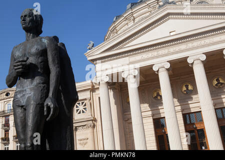 Statue of the poet Mihai Eminescu in front of the Romanian Athenaeum (Concert Hall) in Bucharest - Stock Photo