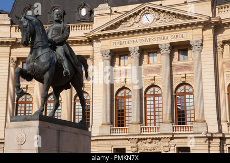 Central University Library with statue of King Carol 1 in the foreground, Bucharest, Romania - Stock Photo